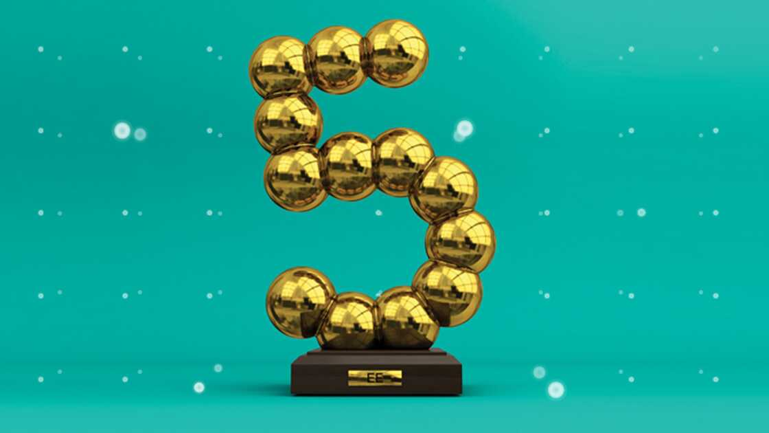 A trophy made of golden balls creating the number five on a plinth with an EE plaque