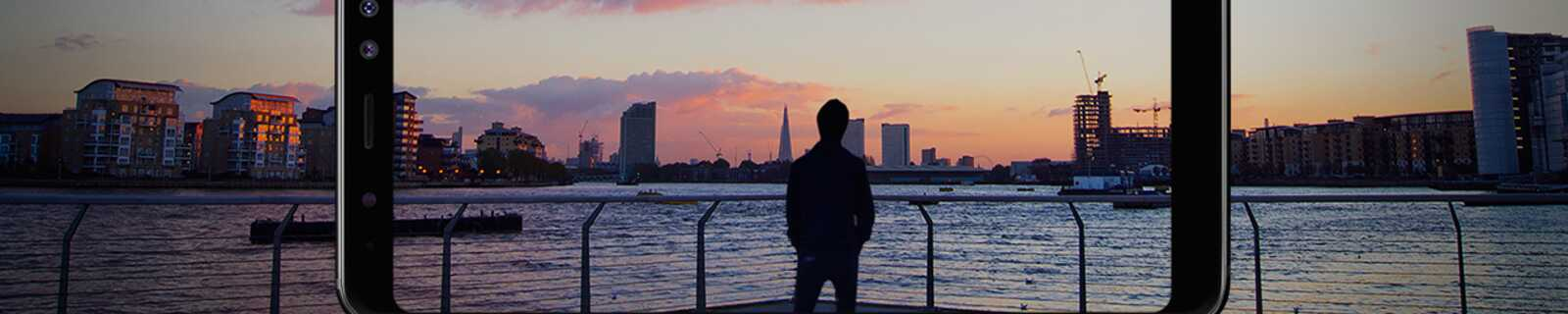 Phone camera capturing man enjoying sunset view over central London