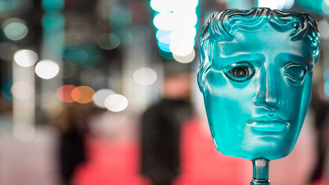 Aqua EE BAFTA mask against a backdrop of the red carpet