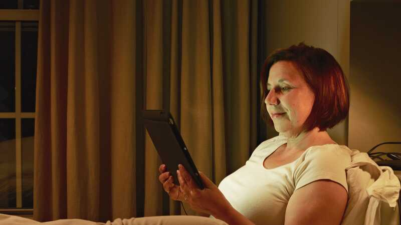 Woman in bed with tablet