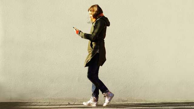 girl walking with phone