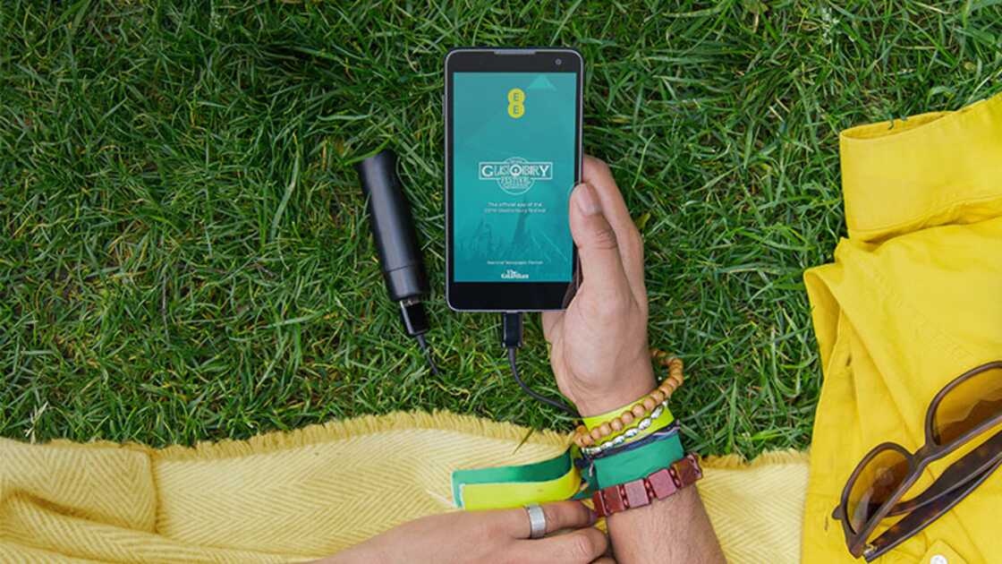 Festival-goer using the official Glastonbury app